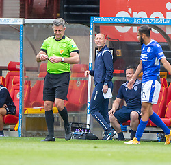 31JUL21 Ref Greg Aitken sends Queen of the South's Manager Allan Johnston afte he reacts to Partick Thistle's Brian Graham's tackle. Partick Thistle 3 v 2 Queen of the South. First Scottish Championship game of the season.