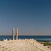 Columns at an ampitheatre in the ruined Roman city Leptis Magna, overlooking the Mediterranean Sea, Libya