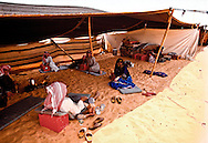 Women socialize with men in the majlis when there are no strangers in the camp. Shammar Tribe, The Nafud, Saudi Arabia