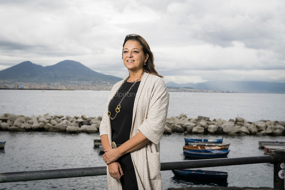 NAPLES, ITALY - 16 OCTOBER 2020: Valeria Fascione (53), Campania's minister for internationalisation, start-ups and innovation, poses for a portrait in Naples, Italy, on October 16th 2020. She is the only regional minister in Italy with such a role, she says, proudly stating that Campania now has Italy's second-fastest growth for start-ups.<br /> <br /> In the past few years Naples been fostering a growing community of tech start-ups and app creators. What has really changed the game for Naples' tech scene is Apple's recent arrival in the city. In 2015, Apple opened its Developer Acamdy in Naples, in conjunction with University of Naples Federico II, where students spend a year training to be developers, coders, app creators and start-up entrepreneurs. <br /> <br /> And where Apple goes, others follow. In 2018, networking giant Cisco opened its own networking academy in Naples.<br /> <br /> The hope is it will change not just Naples' reputation, but also its fortunes and so reverse a brain drain that's seen many of the city's young graduates leave to find jobs in the more prosperous north of Italy, or even abroad. Naples, and its region, Campania, is part of the Mezzogiorno (southern Italy and Sicily) which lags behind the rest of the country in terms of economic growth. Here the youth jobless rate was above 50% in 2019, among the highest unemployment rate in Europe.