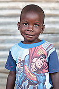 Portrait of a boy in a superman t-shirt in the Clara Town slum of Monrovia, Montserrado county, Liberia on Thursday April 5, 2012.