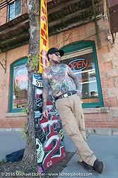 Tattoo artist Rick Webster of the Sturgis Tattoo Company in downtown Sturgis on the final Saturday of the annual Black Hills Motorcycle Rally.  SD, USA.  August 13, 2016.  Photography ©2016 Michael Lichter.