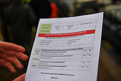 © Licensed to London News Pictures. 15/01/2021. London, UK. A form handed to patients at a vaccination Centre set up in a community hall in White City, West London. Staff work round the clock administering vaccines at a target rate of one every minute, expecting to exceed a daily total of over 500 jabs.The centre has been set up with the associated cold chain in place to distribute thePfizer-BioNTech COVID-19 vaccine, servicing patients from high risk groups. Photo credit: Guilhem Baker/LNP