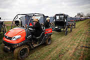 Amish men move buggies using a tractor during the Annual Mud Sale to support the Fire Department  in Gordonville, PA.