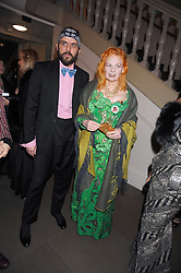 DAME VIVIENNE WESTWOOD and her husband MR ANDREAS KRONTHALER at Chaos Point - a fashion show from Viienne Westwood's Gold Label Collection in aid of the NSPCC at The Banqueting House, London SW1 on 18th November 2008.