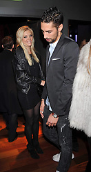 CHELSEY DAVY and HUGO TAYLOR at the launch of the new Chinawhite at 4 Winsley Street, London on 21st October 2009.
