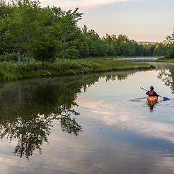 A kayaker on Northeast Creek on Mount Desert Island. Bar Harbor, Maine. Near Acadia National Park.