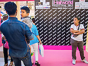 24 JULY 2013 - BANGKOK, THAILAND: People walk in and out of the Hairworld Festival in Siam Paragon, an upscale shopping mall in Bangkok, Thailand.        PHOTO BY JACK KURTZ