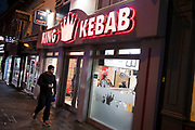 Small business shop front for fast food takeaway King Kebab at night in the Kings Heath area of Birmingham, United Kingdom. Kings Heath is a suburb of Birmingham, three miles south of the city centre. It is the next suburb south from Moseley.