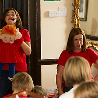 Guests at the 10th Birthday Celebration of Cheshire Down's Syndrome Support Group are entertained by Singing Hands, 2017-07-15