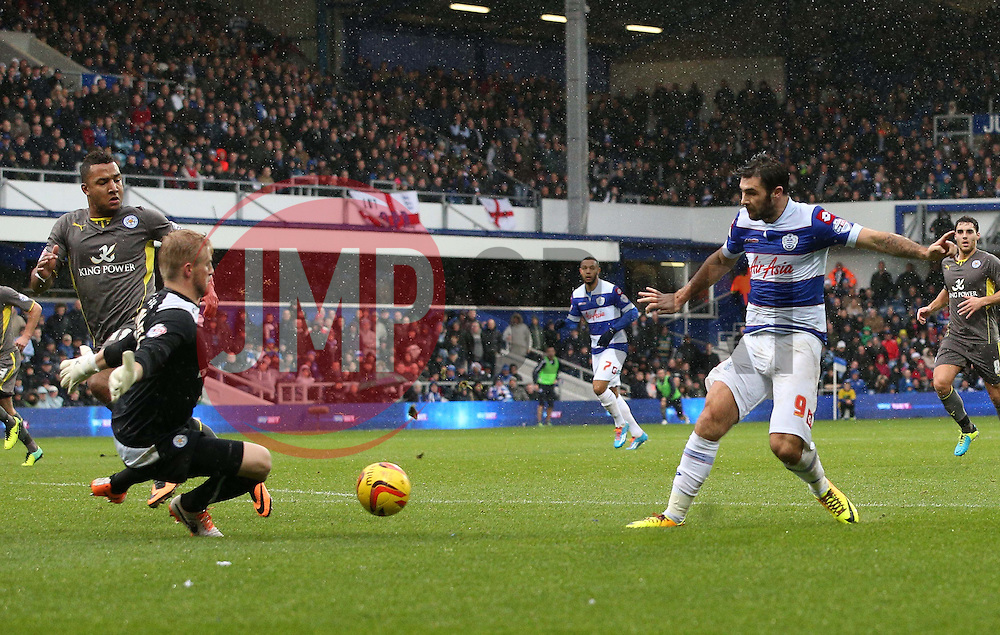 Leicester City's Kasper Schmeichel saves from Queen Park Rangers' Charlie Austin - Photo mandatory by-line: Robin White/JMP - Tel: Mobile: 07966 386802 21/12/2013 - SPORT - FOOTBALL - Loftus Road - London - Queens Park Rangers v Leicester City - Sky Bet Championship