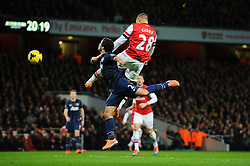 Man Utd Defender Rafael (BRA) and Arsenal Defender Kieran Gibbs (ENG) collide in the air - Photo mandatory by-line: Rogan Thomson/JMP - 07966 386802 - 12/02/14 - SPORT - FOOTBALL - Emirates Stadium, London - Arsenal v Manchester United - Barclays Premier League.