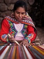 CUSCO, PERU - CIRCA SEPTEMBER 2019:  Portrait of a peruvian woman weaving in the region of the Sacred Valley in Peru/