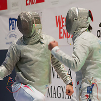 Aron Szilagyi (L) of Hungary and Kim Junghwan (R) of Korea react to scoring during the final of the Gerevich-Kovacs-Karpati Men's Sabre Grand Prix in Budapest, Hungary on March 09, 2014. ATTILA VOLGYI