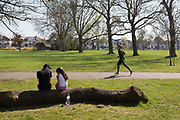 On the first day of the Easter Bank Holiday weekend, and at the end of the second week of lockdown restrictions by the UK government, Londoners use their daily exercise entitlement to spend a warm afternoon in Ruskin Park, a public green space in the borough of Lambeth, on 10th April 2020, in London, England.