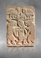 Pictures & images of the North Gate Hittite sculpture stele depicting man with wolves. 8the century BC.  Karatepe Aslantas Open-Air Museum (Karatepe-Aslantaş Açık Hava Müzesi), Osmaniye Province, Turkey. Against grey art background