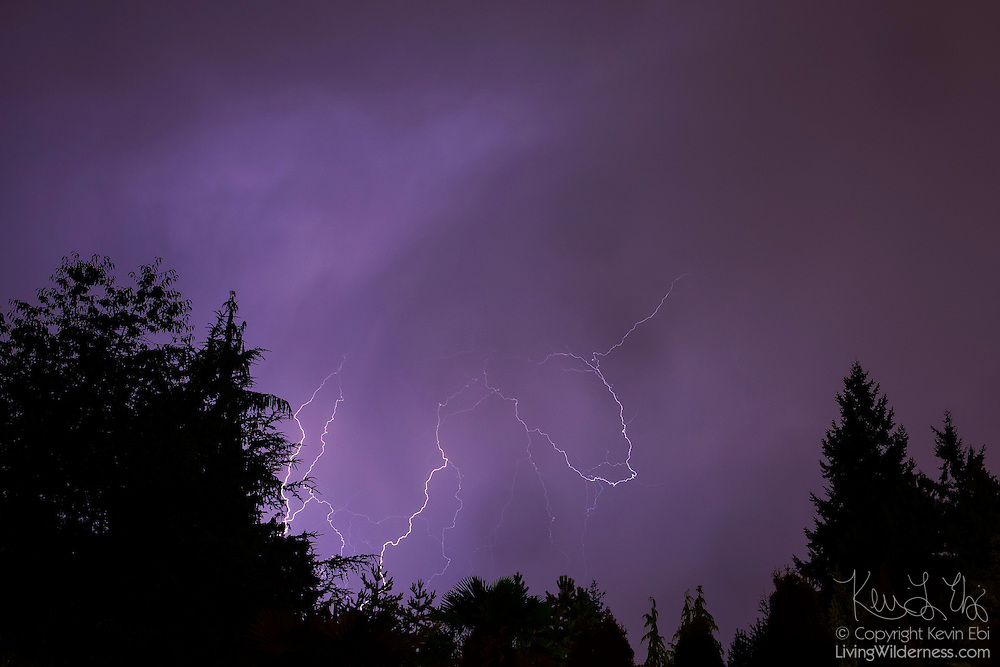 Several lightning flashes light up the night sky during a thunderstorm over Snohomish County, Washington. Lightning is usually produced by towering cumulonimbus clouds, which can climb to heights of more than 9 miles (15 km); the lightning flashes temporarly balance the electrical charge in the cloud. Only about 25 percent of all lightning flashes reach the ground; those flashes are known as strikes.