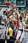 SHOT 2/23/10 10:57:12 PM - Colorado State's Andy Ogide (#32) and Pierce Hornung (#4) battle New Mexico's Roman Martinez for a rebound under the basket during the second half of their regular season Mountain West Conference game at Moby Arena in Fort Collins, Co. New Mexico survived a tight game winning 72-66. (Photo by Marc Piscotty / © 2010)