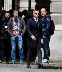 "© Licensed to London News Pictures. 30/05/2015. London, UK. . Filming for the new James Bond film ""Spector"" with Daniel Craig (pictured) and Naomie Harris (not pictured) at the courtyard of the UK Government Treasury building in Westminster, London . Photo credit: Ben Cawthra/LNP"