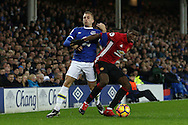 Paul Pogba of Manchester United gets in front of Gerard Deulofeu of Everton. Premier league match, Everton v Manchester United at Goodison Park in Liverpool, Merseyside on Sunday 4th December 2016.<br /> pic by Chris Stading, Andrew Orchard sports photography.