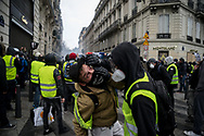 Protesters using sodiume chlorine solution to treat tear gas effects.  More than 125000 gathered in Paris for the Gilets Jaune (Yellow vest) protest. Soon the protest turned violent an protesters clashed with the police, tear gas and flash bombs were fired, many injured and arrested by the police. Paris December 6th 2018. Federico Scoppa