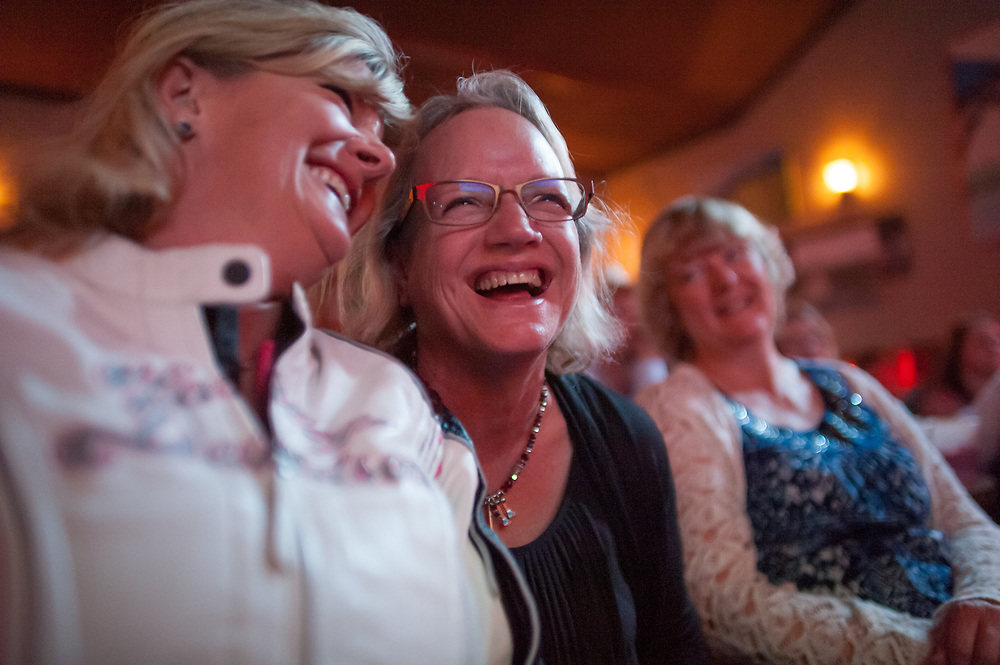 Judy Breland (center), Andy Breland's wife, laughing while watching the premier of Dead End Express.