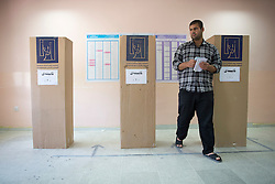 © Licensed to London News Pictures. 30/04/2014. Sulaimaniya, Iraq. An Iraqi-Kurdish male leaves a booth located in a school after casting his vote during the 2014 Iraqi parliamentary elections in Sulaimaniya, Iraqi-Kurdistan today (30/04/2014). <br /> <br /> The period leading up to the elections, the fourth held since the 2003 coalition forces invasion, has already seen polling stations in central Iraq hit by suicide bombers causing at least 27 deaths. Photo credit: Matt Cetti-Roberts/LNP