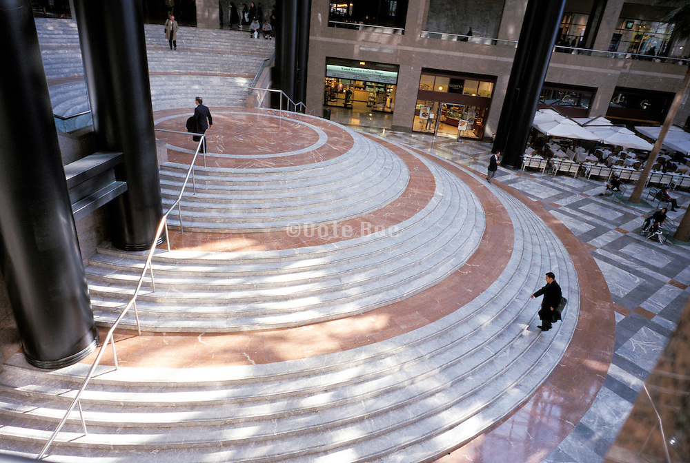 stairs in atrium with people walking up stairs.