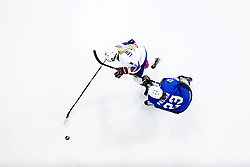 Iceland's Berglind Leifsdottir and Slovenia's Anna Prsina (bottom) battle for the puck during the Beijing 2022 Olympics Women's Pre-Qualification Round Two Group F match at the Motorpoint Arena, Nottingham.
