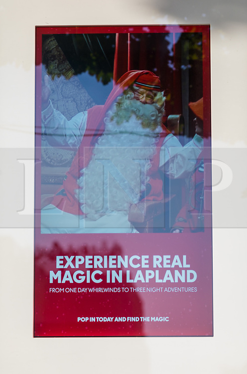 © Licensed to London News Pictures. 23/09/2019. London, UK. An advert for Lapland Christmas holidays is still seen displayed in a branch of Thomas Cook travel agent in Wimbledon that is closed this morning. Thomas Cook has collapsed overnight and ceased trading with immediate effect, leaving thousands of customers stranded on holiday. Photo credit: Vickie Flores/LNP