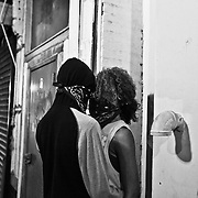 BALTIMORE, MD Tuesday, April 29, 2015: Baltimore's second night of the curfew saw members of the community trying to enforce the order three days after the funeral of Freddie Gray, which sparked major riots and protests around the city.  Credit: Byron Smith