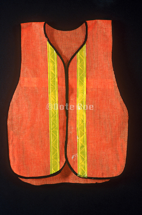 Traffic worker's reflective vest against black surface