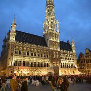 The Grand Place, Brussels, at night. Originally the city's central market place, the Grand-Place is now a UNESCO World Heritage site. Ornate buildings line the square, including guildhalls, the Brussels Town Hall, and the Breadhouse, and seven cobbelstone streets feed into it.