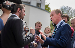 © Licensed to London News Pictures. 16/05/2017. Portsmouth, UK. Liberal Democrat party leader Tim Farron (R) gives media interviews outside the Mary Rose Academy special needs school during a visit. The Lib Dems have today announced plans for education and business during campaigning for the general election on June 8, 2017.  Photo credit: Peter Macdiarmid/LNP