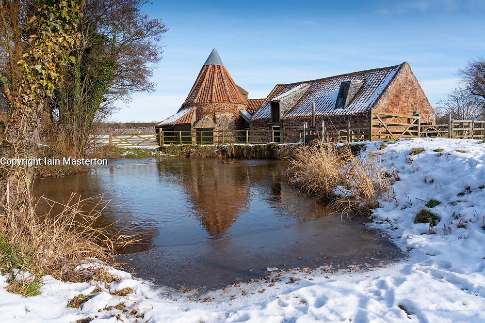 East Linton, East Lothian, Scotland, UK. 13 Feb 2021.  Historic Preston Mill seen in the snow on a bitterly cold sunny day with temperature of -2C.   Iain Masterton/Alamy Live news