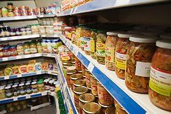 Jars of various pickled products from Poland on shop shelf,