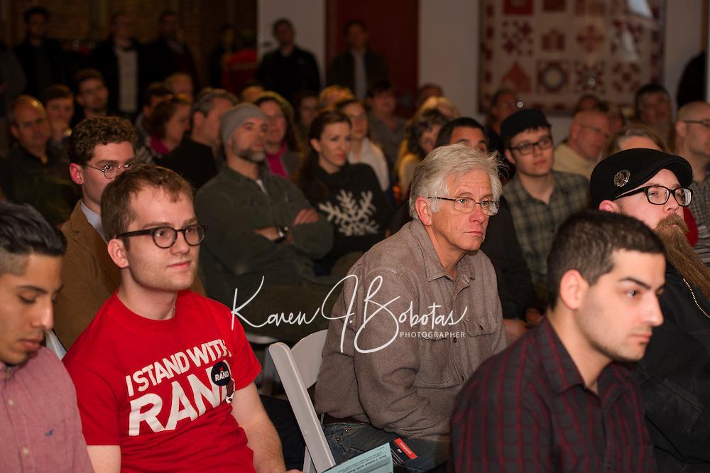 Supporters listen to Senator Rand Paul speak at the Belknap Mill on Monday evening.  (Karen Bobotas/for the Laconia Daily Sun)