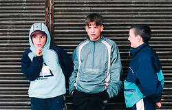 Boys hanging around shops; Bradford council estate; Yorkshire UK