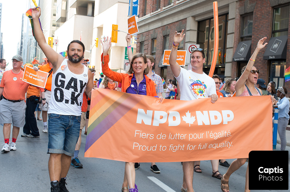 Supporters of the New Democratic Party of Canada march during the parade. August 24, 2014.