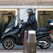 NLD/Amsterdam/20150322 - Ferry de Kok op de motorscooter
