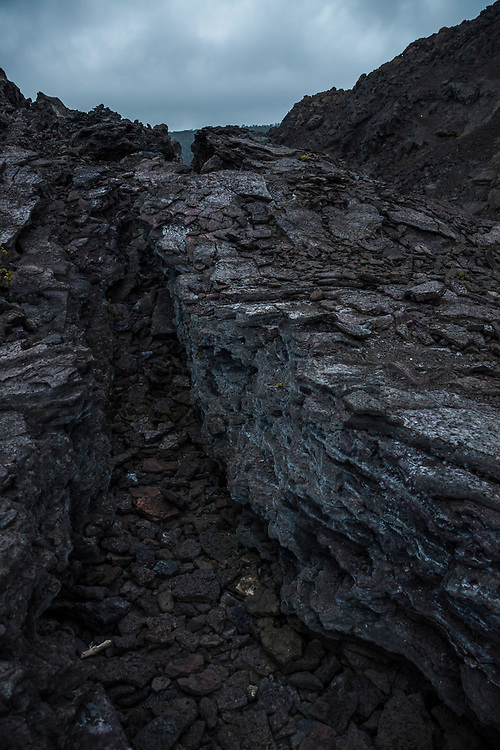 A trench between giant chunks of cooled lava, Pu'u Pua'i or the Gushing Hill, a volcanic feature in Hawaii Volcanoes National Park, Hawai'i, USA