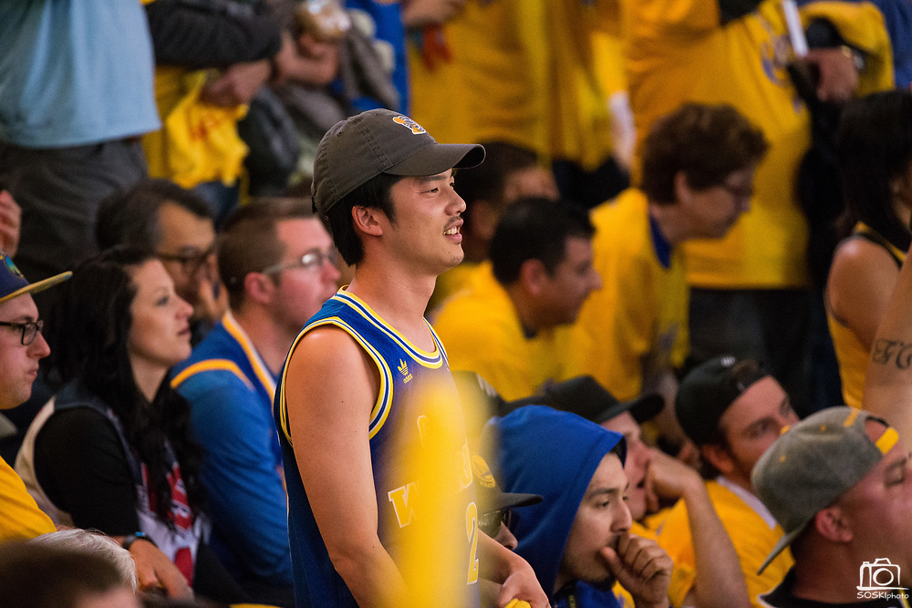 Fans watch Game 2 of the Western Semifinals between the Golden State Warriors and the New Orleans Pelicans at Oracle Arena during in Oakland, California, on May 1, 2018. (Stan Olszewski/Special to S.F. Examiner)