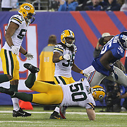 Andre Brow, New York Giants, is tackled by A.J. Hawk during the New York Giants Vs Green Bay Packers, NFL American Football match at MetLife Stadium, East Rutherford, New Jersey, USA. 17th November 2013. Photo Tim Clayton