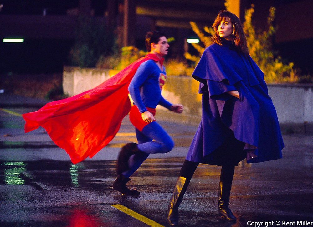 Superman Kurt Aderle isn't the only one who's discovered that capes pack a fashion punch. Michelle Todorow models royal blue, street-length capes (about $120) from Burlington Coat Factor. Superman costume courtesy of Alfred's House of Costumes in Genesee Township.