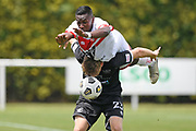 Waitakere United's Shuiab Khan goes over the top of Hawke's Bay United's Jorge Akers in the Handa Premiership football match, Hawke's Bay United v Waitakere United, Bluewater Stadium, Napier, Sunday, December 20, 2020. Copyright photo: Kerry Marshall / www.photosport.nz