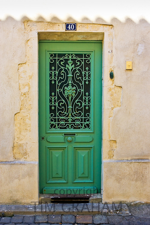 Traditional door with metal design, Ile De Re, France.