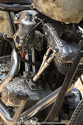 A custom Harley-Davidson Shovelhead by Vlad Romanov of Leecoln Hotrods sports amazing deep hand engraving by a Siberian engraver on display at the Custom and Tuning Show, which was part of the big Motor Spring show in Moscow, Russia. Friday April 21, 2017. Photography ©2017 Michael Lichter.