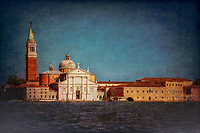 """""""View from the Grand Canal of the church of San Giorgio Maggiore in Venice - Blue and Red""""…<br /> <br /> The first church on the island was built about 790, and in 982 the island was given to the Benedictine order by the Doge Tribuno Memmo. The Benedictines founded a monastery there, but in 1223 all the buildings on the island were destroyed by an earthquake. Andrea Palladio, an Italian Renaissance architect active in the Venetian Republic was commissioned for the rebuild. Palladio, influenced by Roman and Greek architecture, is widely considered to be one of the most influential individuals in the history of architecture, began the rebuild in 1560 and made dramatic improvements. The campanile was rebuilt in neo-classic style and completed in 1791. It was ascended by ramps and now an elevator to the top for panoramic views of Venice. The facade is brilliantly white and represents Palladio's solution to the difficulty of adapting a classical temple facade to the form of the Catholic Basilica. Two very large paintings by Tintoretto relate to the institution of the Eucharist and are located on either side of the presbytery, where they can be seen from the altar rail. """"The Last Supper"""" and """"The Jews in the Desert"""" (collecting and eating the manna, a gift of God to the Israelites in the Desert after they escaped Egypt, which foretells the gift of the Eucharist). Claude Monet painted a series of paintings of the island Monastery of San Giorgio Maggiore in 1908 during the artist's only visit to the city. One of the best known is """"San Giorgio Maggiore at Dusk"""", which exists in two versions. Monet completed his paintings of Venice at home in France and in 1912 showed them in Paris. Buyers included the Welsh collector Gwendoline Davies, who bought three paintings. This vision of the Church of San Giorgio is iconic and famous worldwide. My image capture while upon an evening boat excursion appears theatrical as if the majestic church is posing for yet another Venetian canvas."""