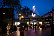 Night time scene outside Embankment underground station in central London.