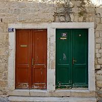 Double doors, brown & green.<br />Split, Croatia. 2018